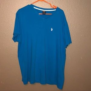 Polo shirt. Worn once. Small tear. Good condition